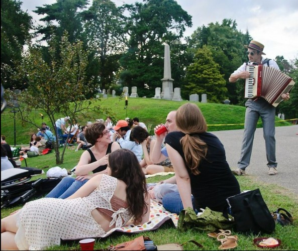 The entertainment began with accordianist Albert Behar serenading visitors as they picnicked next to Crescent Water.
