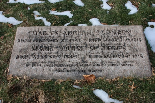 """This gravestone, in front of """"The Angel of Death,"""" memorializes Mr. and Mrs. Schieren, who died within hours of each others."""