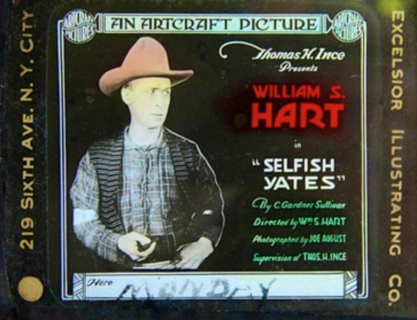 """A coming attraction slide for """"Selfish Yates,"""" starring silent movie cowboy William S. Hart. This is one of about 50 such slides for Hart movies in The Green-Wood Historic Fund's Collections."""