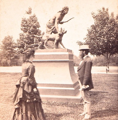 """""""The Indian Hunter"""" stands in Central Park. Here it is shown there in a half-stereoscopic view, circa 1875."""