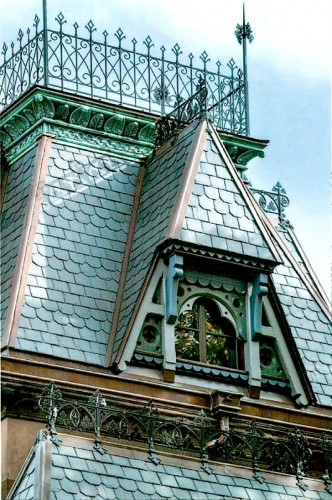 The restored cast iron cresting included this widow's walk atop the gatekeeper's residence.