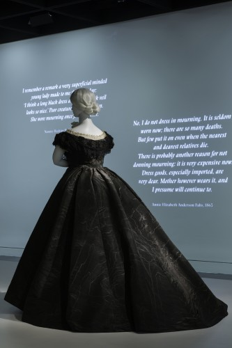 The exhibition makes good use of quotations pertaining to mourning, projecting them onto the painted walls.Gallery View Anna Wintour Costume Center, Lizzie and Jonathan Tisch Gallery Image: © The Metropolitan Museum of Art