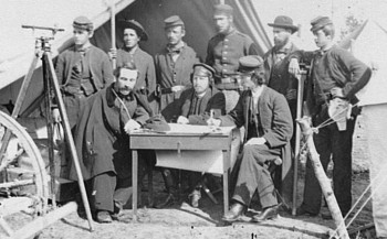 Union topographical engineers, Army of the Potomac, at Camp Winfield Scott, near Yorktown, Virginia, likely May, 1862. Captain William H. Paine is seated at left. Courtesy of the Library of Congress.