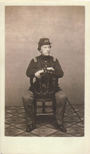 Here Surgeon Cheeseman wears a single breasted frock coat; federal regulations stipulated that an officer was to wear a coat with two lines of buttons.
