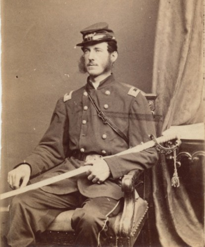 Lieutenant Colonel Lloyd Aspinwall, posing in a photographer's studio.