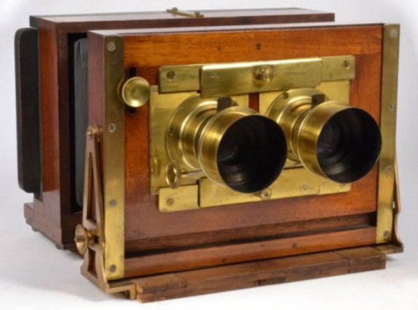 "A 19th-century stereoscopic camera with two lenses. With these two lenses, a negative could be exposed that was approximately 6"" x 3"". Two slightly-different images, captured at approximately the distance between a typical human's eyes, made it possible to see a 3-D scene."