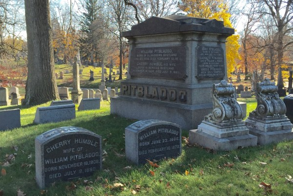 The Pitbladdo family lot at Green-Wood. Note the gravestones of William Pitbladdo and his wife, Cherry, at front. And notice that the gray granite is not the only material in the lot; two intricately-carved marble monuments are at right.