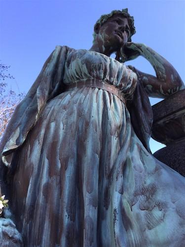 The bronze figure in the Ludin Lot was sculpted by Emilio F. Piatti.