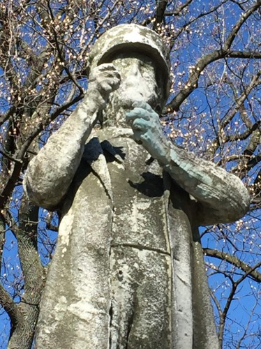 Detail of the Sea Captain. Note the green wash on the left hand. The marble figure, as designed, held the sextant (a navagational device) that was used by Captain John Correja to guide his ship across the seas.