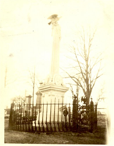 Photograph, circa 1875, showing the Vosburgh Monument and the cast iron fence around it. Note the fence posts, cast in the shape of Civil War muskets.