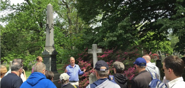 "Baseball historian and author Tom Gilbert talking about Duncan Curry, one of James Whyte Davis's Knickerbocker teammates, at Curry's grave. His gravestone describes him as a ""Father of Base Ball."""