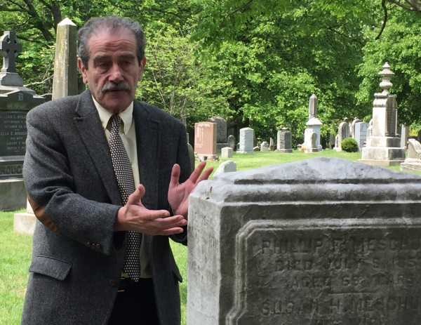 Major League Baseball's brilliant historian, John Thorne, at the grave of Louis Fenn Wadsworth. Wadsworth's name is carved on the side of the stone, where Thorne's hands are.