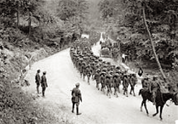 Men of the 307th Infantry Regiment regimental band, marching on a road near Famechon, France, 7 June 1918.