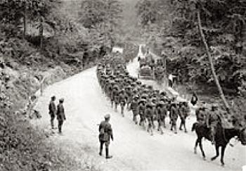 Men of the 307th Infantry Regiment regimental band, marching on a road near Famechon, France, 7 June 1918.