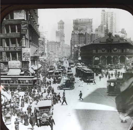 Herald Square, early in the 20th century. The Herald Building, headquarters of the New York Herald newspaper, is the dark, low building at right midground. The tall building in the distance up Broadway is the Times Building. The founders of both newspapers, James Gordon Bennett for the Herald and Henry Raymond for the Times, are interred at Green-Wood.