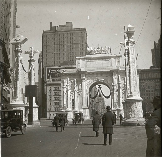 This Victory Arch, a temporary structure erected just to the west of Madison Square Park, was where the crowd surged into the streets to greet the marchers.