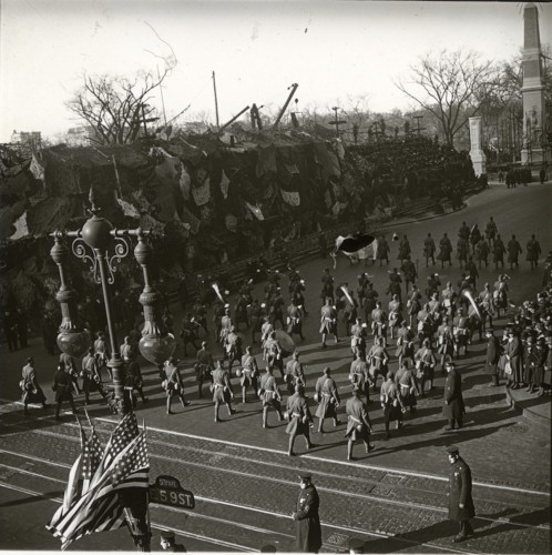 Soldiers on parade. Note the street sign at right.