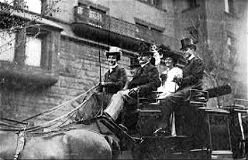 Gladys, in happier days, driving a coach in New York City.