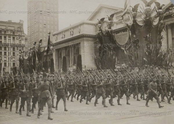 Parading in front of the New York Public Library. Courtesy of the New York City