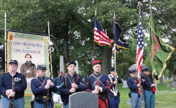 Civil War re-enactors and color guards framed the scene.