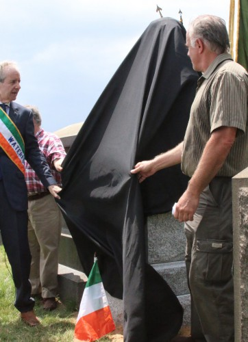 Left to right, Peter Mackay of the County Waterford Association, Jeff Richman of Green-Wood (partially hidden), and sculptor Michael Keropian, unveiling the Meagher Memorial.