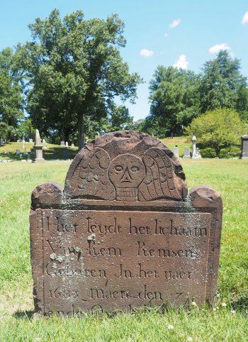 skull grave green-wood