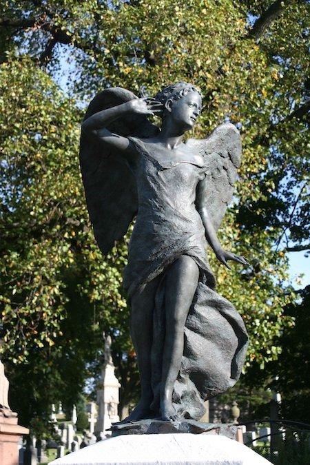 angel statue green-wood